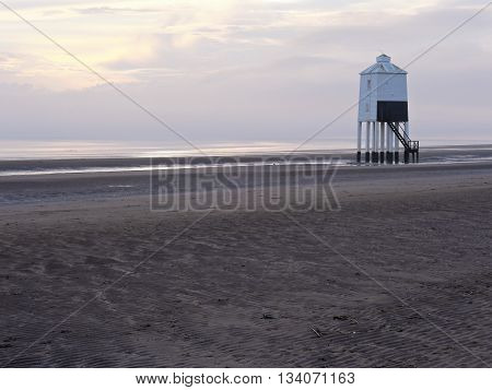 Burnham on Sea beach at low tide, showing the wooden lighthouse in the background.