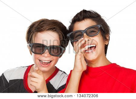 Portrait of a two happy boys wearing 3D glasses watching comedy movie and laughing, isolated on white background, cheerful friends enjoying cinema