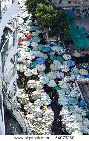 Phnom Penh market, cambodia, Asian food market. Multi-colored ambrellas.