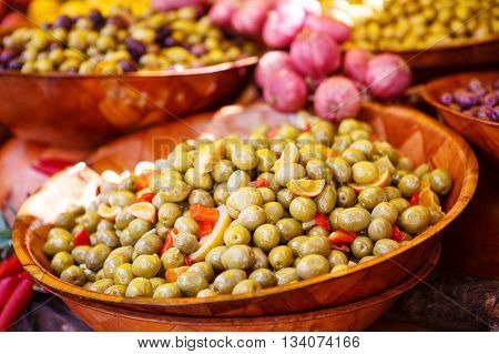 Marinated garlic and olives on provencal street market in Provence, France. Selling and buying.