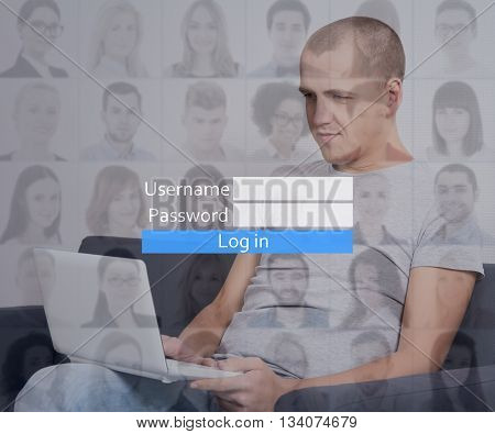 young handsome man with laptop registering account in social network