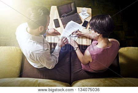 Teamwork. Man and woman are reading working papers