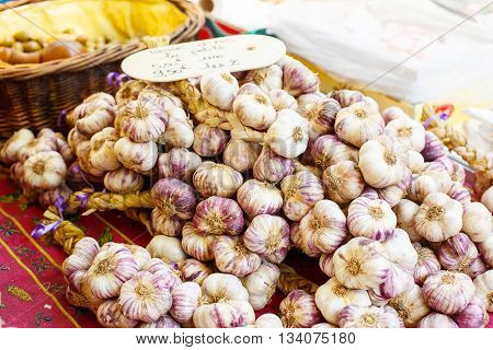 French garlic display in market in south of France, Arles, Provence. Local organic food.