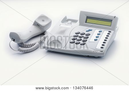 The telephone set of offhook milk white color is ready to a call