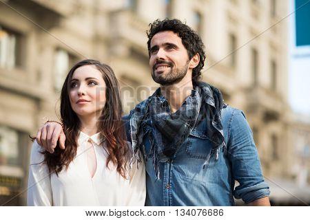 Couple walking in an urban street
