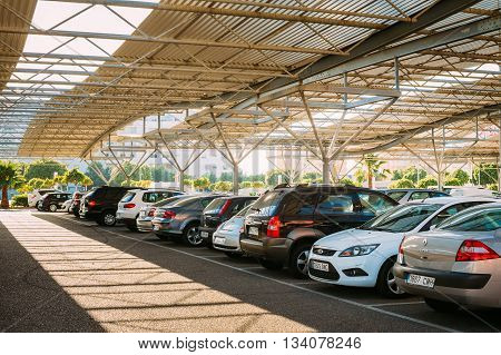 Fuengirola, Spain - June 24, 2015: Cars on a parking lot in sunny summer day