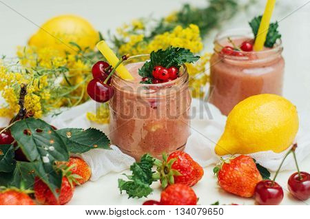 Banana And Strawberry Smoothie. Two Cold Strawberry Banana Smoothies In Glasses With Ingredients On
