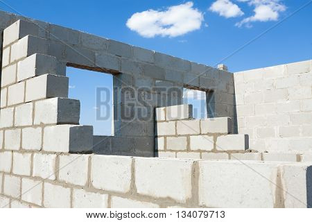 building of the house from a stone