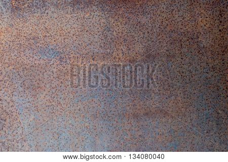 old brown rusty sheet of metal corrosion as a background