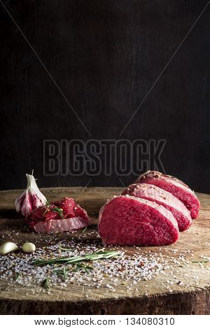 a juicy piece of meat lying on a wooden board. Flavored with spices