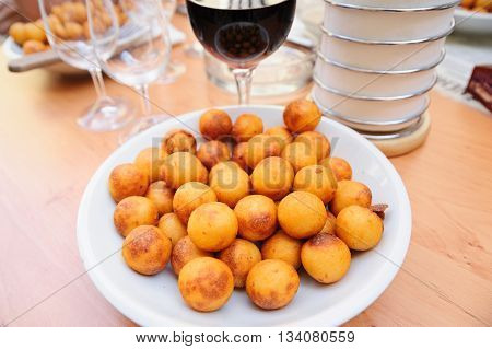 Traditional Czech croquettes made of cheese and potatoes in street cafe