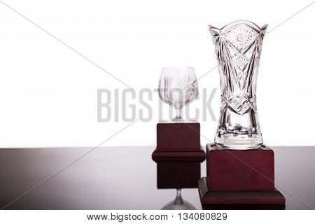 Two Crystal Trophies With Focus On Vase Trophy At Foreground