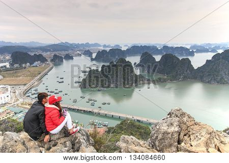 Hanoi Vietnam: February 24 2016: Young couple enjoying the view of Halong Bay from the top of the mountain