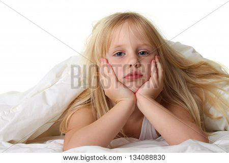 Bedtime - child in bed with white blanket