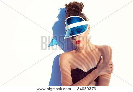 Summer beach style  portrait of a beautiful young woman wearing bikini sun visor. Fashion beauty and make up cosmetics concept