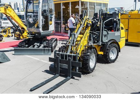 RUSSIA MOSCOW - May 31 2016: World's First Electric Forklift at the International Specialized Exhibition of Construction Equipment and Technologies at Crocus Expo
