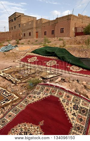 MOROCCO - AUGUST 01: Traditional berber carpets drying in open air in Morocco August 01 2015. Morocco is one of the most popular tourist place in North Africa.
