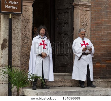 Verona Italy September 27 2015: Two men dressed as Templars stand at the entrance to the church S. Pietro Martire in Verona Italy