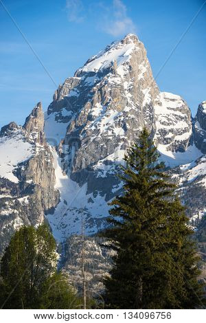 Beautiful rugged rocky Teton snow capped mountain range blue sky majestic landscape scene