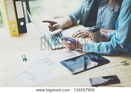 Sales team discussion process.Business crew working with new startup project.Notebook, tablet wood table, using devices.Creative Idea presentation.Analyze market stock.Blurred background, film effect