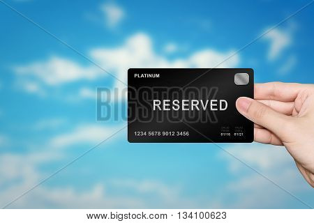 hand picking reserved platinum card on blur background