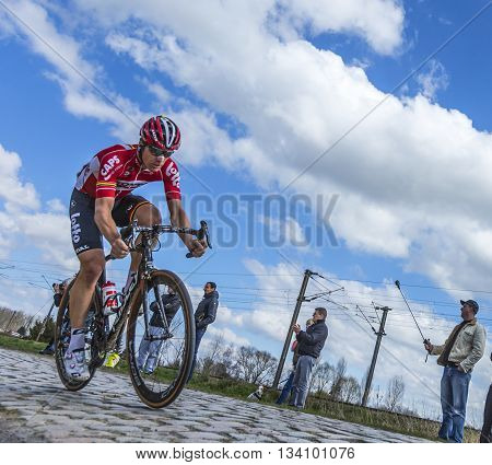 Hornaing France - April 10,2016: The Belgian cyclist Jurgen Roelandts of Lotto-Soudal Team riding on a paved road in Hornaing France during Paris Roubaix on 10 April 2016.