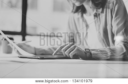 Work process modern Design Office.Hipster working wood table new freelance business startup.Marketing Department Research Process.Touch Screen Digital Tablet.Horizontal, black white.Blurred background