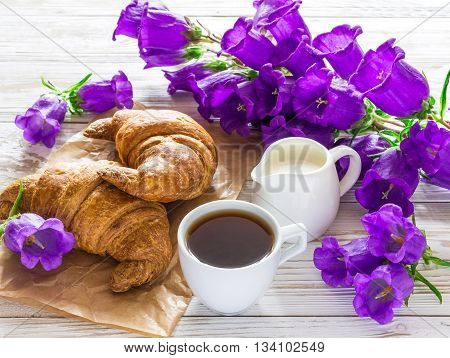 Cup Of Coffee, Croissants, Milk Jar And Lilac Flowers