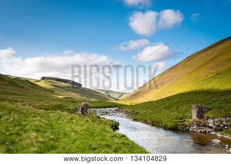 The River Coquet flows from the Cheviot Hills in Upper Coquetdale Valley, on a sunny day