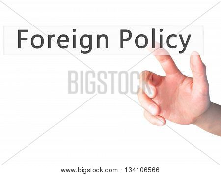 Foreign Policy - Hand Pressing A Button On Blurred Background Concept On Visual Screen.