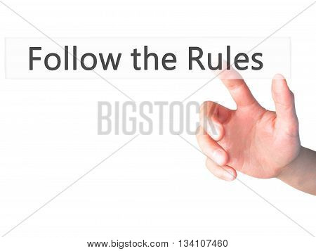 Follow The Rules - Hand Pressing A Button On Blurred Background Concept On Visual Screen.