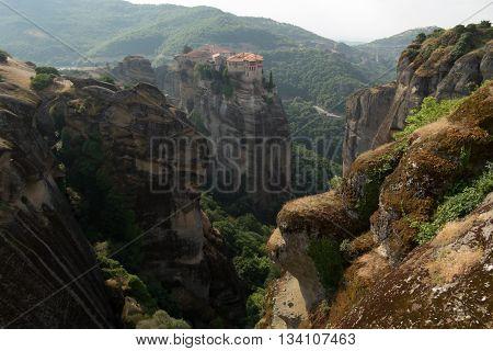 Cliff top monasteries distant view in Meteoras Greece
