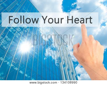 Follow Your Heart - Hand Pressing A Button On Blurred Background Concept On Visual Screen.