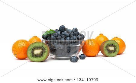 ripe kiwi tangerines and blueberries on a white background. horizontal photo.