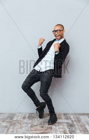 Cheeful african american young man celebrating success