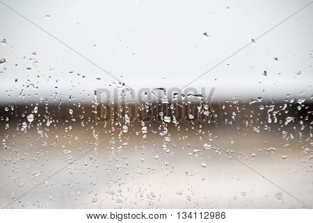 Photograph of a wet cristal with water drops