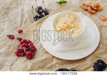 Millet porridge with pumpkin. Brown parchment background