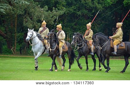 Silsoe, Bedfordshire, England - May 30, 2016:  Four members of the Punjab Lancers in World War One uniform riding horses.