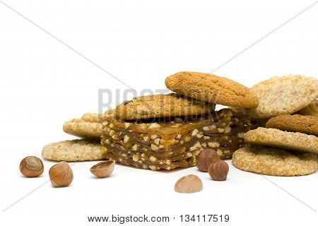 Sweet dessert: chocolate chip cookies nougat and nuts isolated on a white background