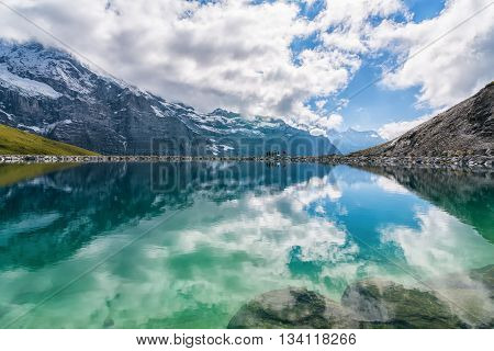 Spectacular view of Swiss alps reflected in the lake