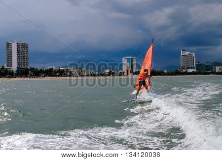NHA TRANG, VIETNAM, March 14, 2016 tourists, boating, surfing, coast of Nha Trang, Vietnam. This is the most beautiful beaches, central Vietnam