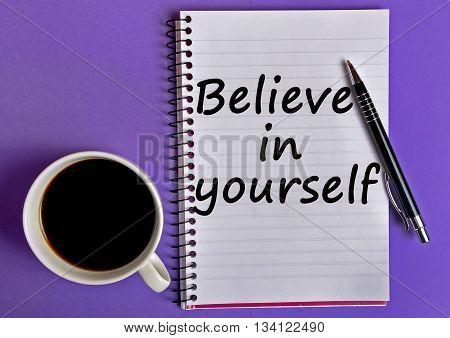 Believe in yourself words on notebook page