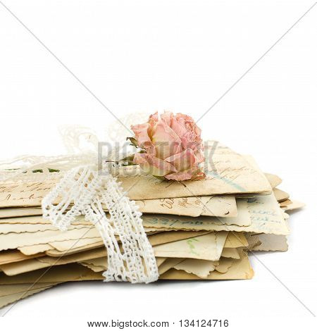 Stack of old love letters (1890-1910) lace and rose flower