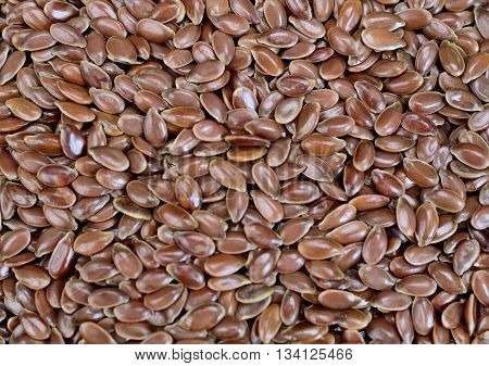 Group of flax seeds in background closeup