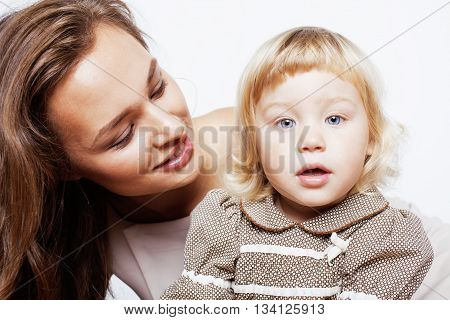 young pretty stylish mother with little cute blond daughter hugging, happy smiling family, lifestyle people concept