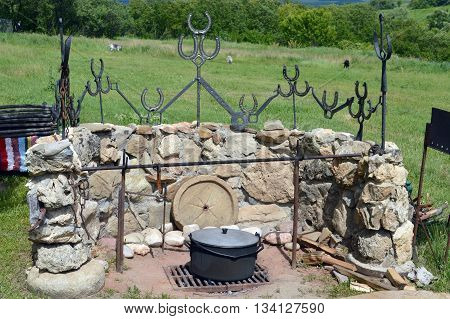 decorative stone hearth with lots of Kazan outdoors