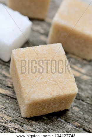 Group of sugar cubes on wooden table