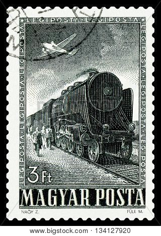 STAVROPOL RUSSIA - APRIL 03 2016: A Stamp printed in Hungary shows old Lokomotive and plane circa 1955