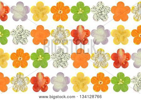 Flower shaped fruit and vegetable on white background