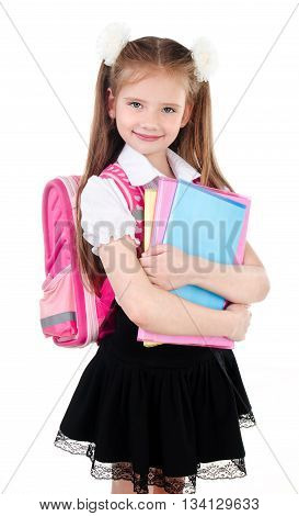 Portrait of smiling schoolgirl in uniform with books and backpack isolated on a white background